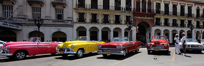 Taxi drivers with US-made vintage convertibles in Havana