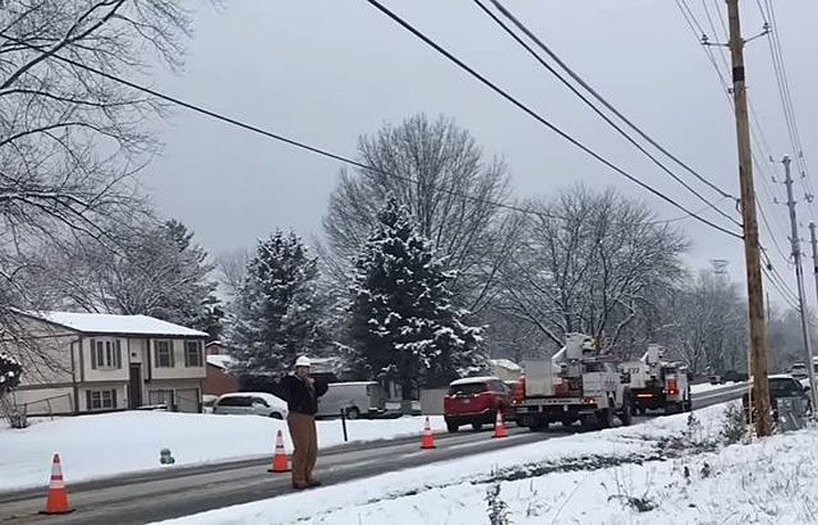 comcast-workers-park-their-trucks-on-snowy-street