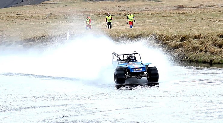 Grimsson hydroplaning a river in 1600hp formula offroad truck