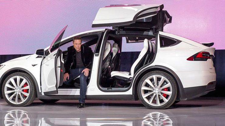 Elon Musk with Tesla model X