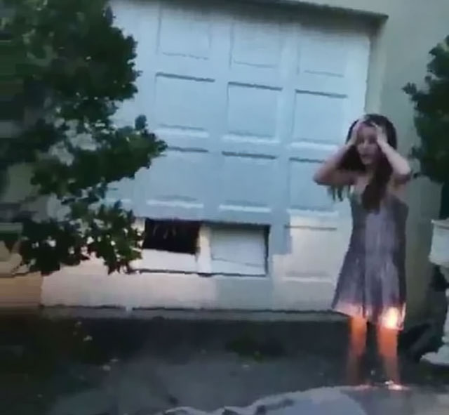 girl drove straight into garage door