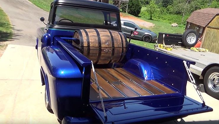 1955 Chevrolet Street truck with a whiskey barrel in its bed