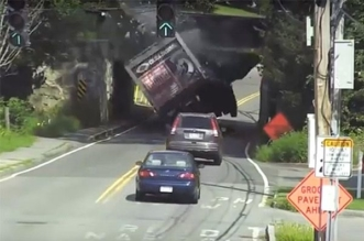 careless truck driver hits infamous low bridge in Massachusetts