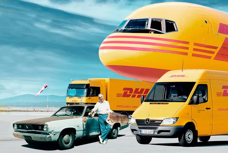DHL fleet with their's first delivery car 1969 Plymouth Duster