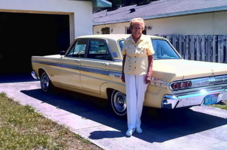 Rachel Veitch stand in front of her 1964 Mercury Mercury Comet Caliente