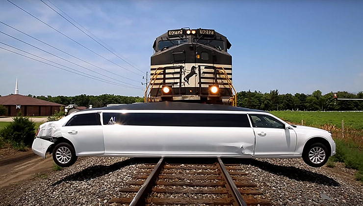 Stretch limo hit by train