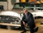 Jay Leno in front of his 1955 Buick Roadmaster