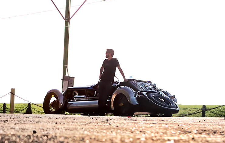 JT Nesbitt standing by Magnolia Special roadster