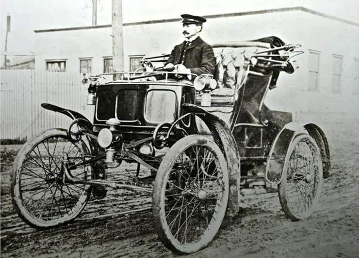 William Doud Packard driving a single-cylinder Model A Packard in 1900